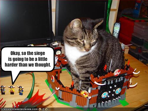 Funny-pictures-legos-try-to-lay-siege-on-the-cat