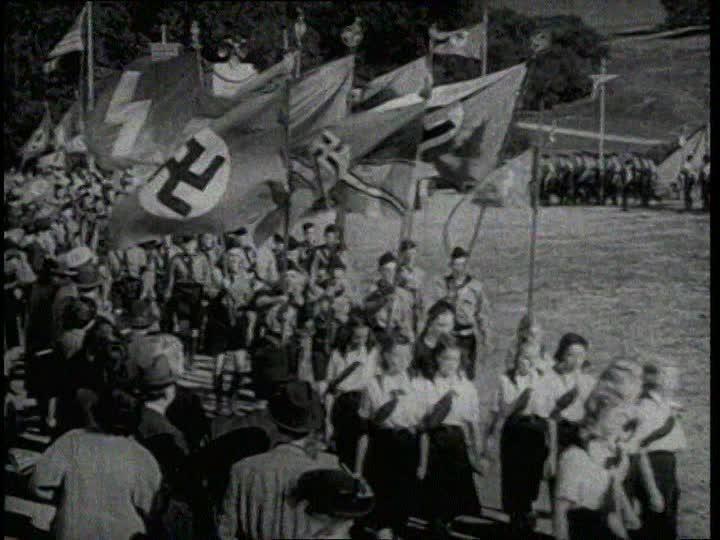 German-american-bund-hitler-salute-trumpet-swastika-flag